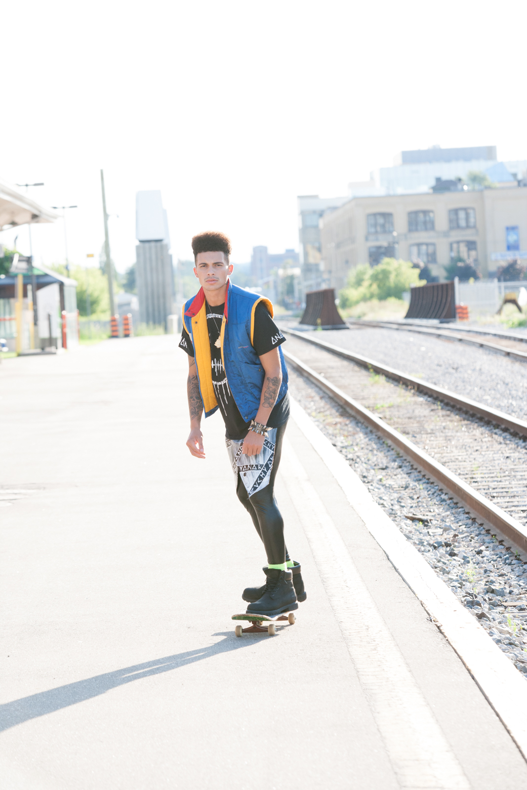 Brandon is killing it on the skateboard! He's wearing an original BMW Racer vest with an Evolve and Rebel tee. He is really the only guy I know that can get away with wearing those slick leggings too!